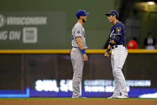 Christian Yelich said it's impossible not to know how Dodgers star Cody Bellinger (left) is doing because they're stellar seasons are compared so much in discussions on the NL MVP race.