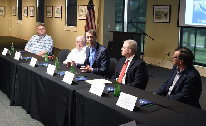 U.S. Sen. Tom Cotton, center, is flanked by, from left, Clint Czeschin, Calvin  Czeschin, Lang Zimmerman and Dr. Robin Myers on Tuesday at a business roundtable discussion at Arkansas State University-Mountain Home.