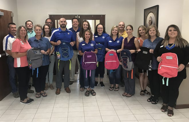 Junior Auxiliary of Mountain Home recently presented 300 backpacks to Mountain Home Public Schools. Community donations at Junior Auxiliary's annual Stuff the Bus event allowed for the local chapter to purchase backpacks and additional supplies for students across Baxter County.