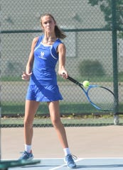 Mountain Home's Macie Heide hits a forehand against West Memphis on Tuesday.