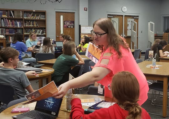 Youth Services Librarian Amy Johnson from the Donald W. Reynolds Library Serving Baxter County hands out and instructs students on the use of Library Tech Cards for the 2019-2020 school year.