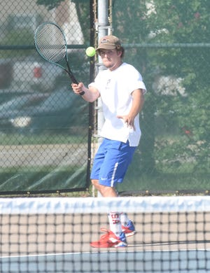 Mountain Home's Banks Gregory returns a shot against his West Memphis opponent on Tuesday.