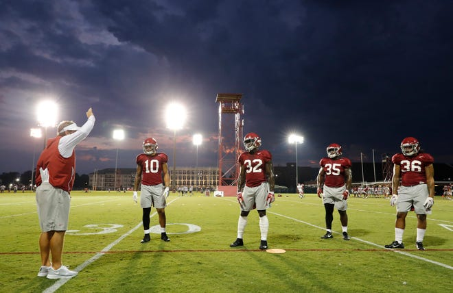 Alabama defensive coordinator Pete Golding works inside linebackers Ale Kaho (10), Dylan Moses (32), Shane Lee (35 and Markail Benton (36) during a recent preseason practice under the lights on Aug. 19, 2019 in Tuscaloosa, Ala. (Photo by Kent Gidley/Alabama athletics)