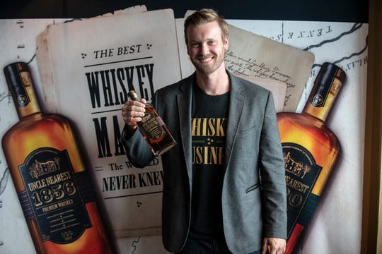 Steven Henderson, VP of sales for Uncle Nearest Premium Whiskey in the Southeast, brought whiskey for guests to sample at Riverwalk Stadium on Tuesday, Aug. 20, 2019.