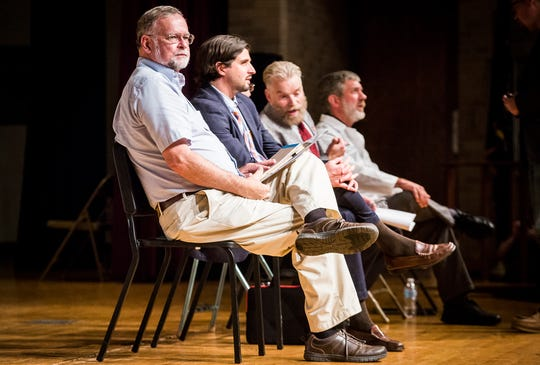 Ball State faculty members Jim Rybarczyk, John West and John Pichtel, left to right, wait on stage with Dr. Robert Byrn at a forum at Central High School on the Waelz project.