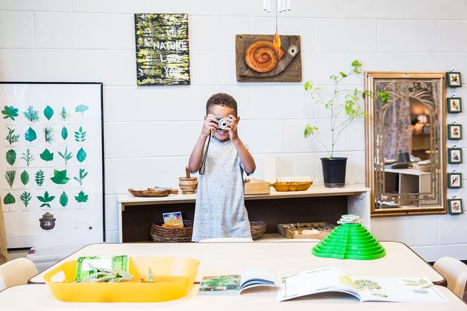 Student Preston Sneed works on his photography skills at the Mitchell Early Childhood and Family Center.