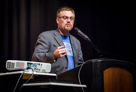 Pastor Josh Arthur speaks at a forum on the Waelz Sustainable Products project at Central High School in August.