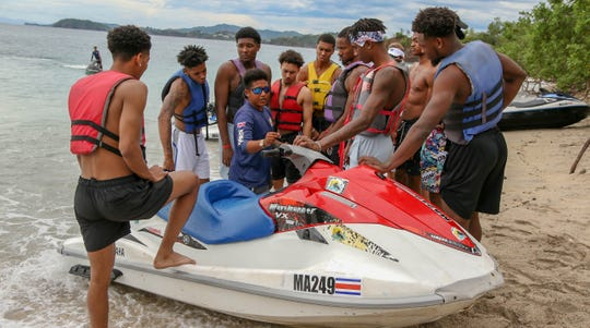 MTSU players gather around to learn how to drive a jet ski during the team's trip to Playa Conchal.