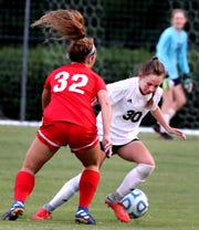 Siegel's Madison Whitworth (30) tries to deflect the ball as Oakland's Avery Casteel (32) tries to get to the goal on Tuesday Aug. 20, 2019, at Siegel Park.