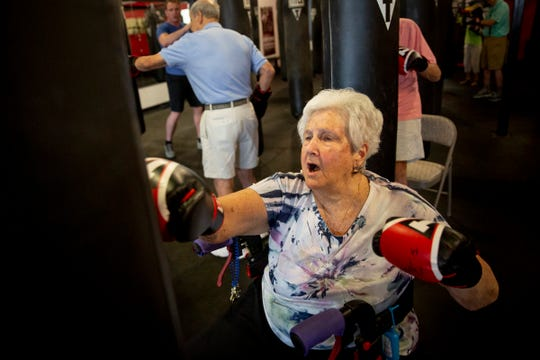 Virginia Poirier, 86, punches the bag during a boxing class for Carlisle residents at Title Boxing Club in Naples on Tuesday, August 20, 2019.