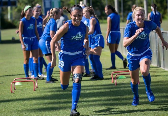 Syniah Clark, left, warms up with her FGCU soccer teammates on Wednesday, August 21, 2019. Clark is a graduate of Ida Baker High School in Cape Coral.