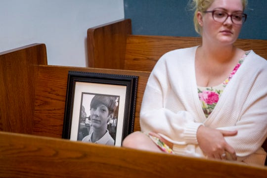 Miranda Jenner sits next to a photo of her brother, Shayden Colvin, during a pre-trial hearing for Pedro Silva-Diaz, the man accused in a 2017 hit-and-run that killed Shayden, at the Collier County Courthouse in Naples on Wednesday, August 21, 2019.