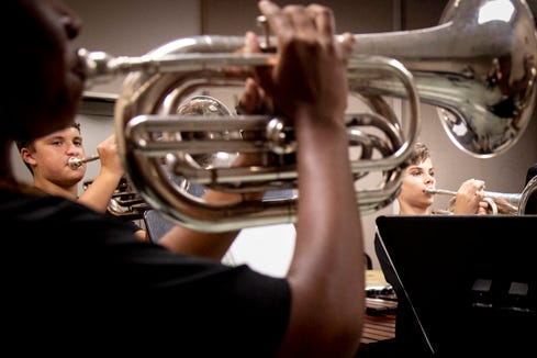 "Members of the baritone section, Ahsiya Cumberbatch, front, and Noah Durik, right, play songs ranging from The National Anthem to Katy Perry's ""Dark Horse"" during marching band practice at Palmetto Ridge High School on Thursday, August 15, 2019."