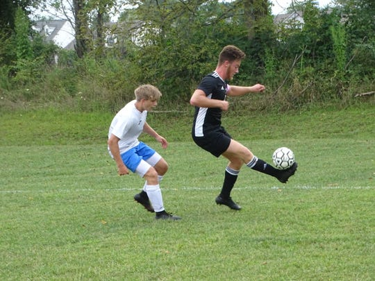 Liberty Christian junior Luke Eckels maintains possession Tuesday during a 2-2 tie against visiting Madison Christian.