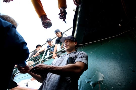 Aug 20, 2019; Oakland, CA, USA; New York Yankees outfielder Giancarlo Stanton (29) signs autographs for fans prior to the game against the Oakland Athletics at Oakland Coliseum. Mandatory Credit: Cary Edmondson-USA TODAY Sports