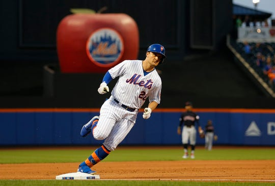 J.D. Davis #28 of the New York Mets runs the bases after his second inning two run home run against the Cleveland Indians at Citi Field on Aug. 20, 2019 in New York City.