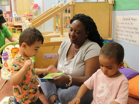 Children and a caregiver at the Early Head Start program in Paterson
