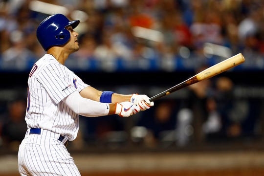 Aug 20, 2019; New York City, NY, USA; New York Mets right fielder Michael Conforto (30) hits a two run home run against the Cleveland Indians during the sixth inning at Citi Field.