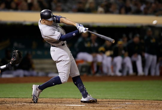 New York Yankees' Aaron Judge swings for a home run off Oakland Athletics' Joakim Soria during the eighth inning of a baseball game Tuesday, Aug. 20, 2019, in Oakland, Calif.
