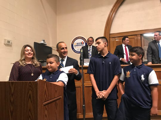 Bergenfield's new Police Chief Mustafa Rabboh with his wife, Eva, and his sons, Aiden, Ameer, and Adam after Rabboh was officially sworn as chief during the Borough Council meeting on August 20.