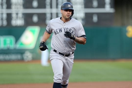 Aug 20, 2019; Oakland, CA, USA; New York Yankees catcher Gary Sanchez (24) prepares to round third base after hitting a home run against the Oakland Athletics in the first inning at Oakland Coliseum. Mandatory Credit: Cary Edmondson-USA TODAY Sports