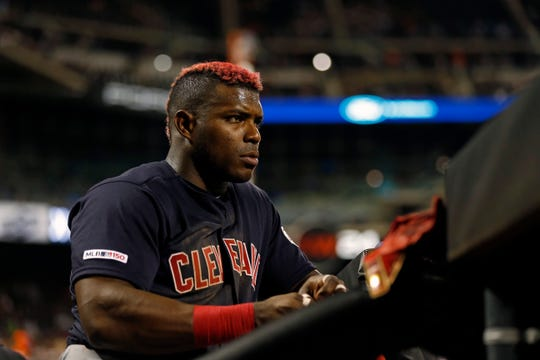 Aug 20, 2019; New York City, NY, USA; Cleveland Indians right fielder Yasiel Puig (66) looks on from the dugout against the New York Mets during the fifth inning at Citi Field.