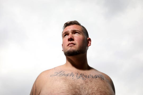 """Chef Daniel Brunina, poses at the site of his new restaurant in Jersey City.  The tattoo on his chest reads, """"Push Yourself"""" a rallying cry from a chef he worked for in West Virginia.   Wednesday, August 21, 2019"""