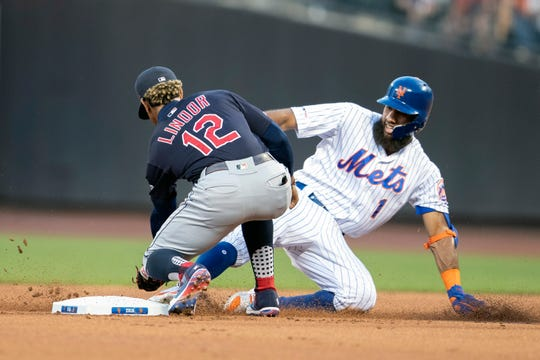 Cleveland Indians' Francisco Lindor (12) forces New York Mets' Amed Rosario (1) out at second during the first inning of a baseball game, Tuesday, Aug. 20, 2019, in New York.
