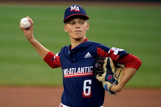 Elizabeth, New Jersey's Sal Garcia (6) delivers during the first inning of an elimination baseball game against Barrington, Rhode Island at the Little League World Series tournament in South Williamsport, Pa., Tuesday, Aug. 20, 2019. New Jersey won 2-0. (AP Photo/Gene J. Puskar)