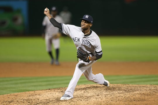 Aug 20, 2019; Oakland, CA, USA; New York Yankees pitcher Domingo German (55) delivers a pitch against the Oakland Athletics in the sixth inning at Oakland Coliseum. Mandatory Credit: Cary Edmondson-USA TODAY Sports