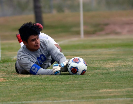Carlsbad goalie Eduardo Aguilar makes a save against Las Cruces in August. On Wednesday he had 13 saves against Clovis, allowing Carlsbad to get a 1-0 double overtime win.