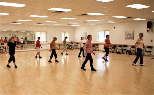 Participants in a line dancing class run through their steps at the Bonnie Dallas Senior Center on Aug. 21.