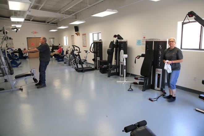 Members of the fitness center at the Bonnie Dallas Senior Center work out on Aug. 21.
