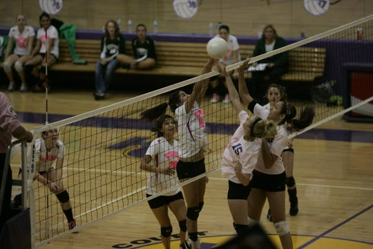 Hannah Hamblin, then known as Hannah Washburn, is seen wearing the number 15 jersey during a 2011 Kirtland Central High School volleyball game against Farmington High School.