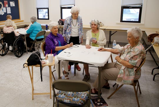 Participants in a bridge class play a hand on Aug. 21 at the Bonnie Dallas Senior Center.