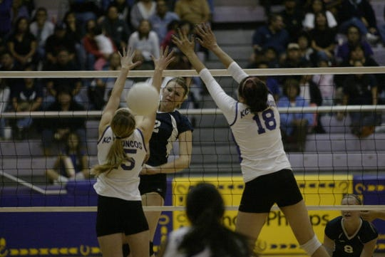 Hannah Hamblin, formerly known as Hannah Washburn, played for Kirtland Central High School. She is pictured during a game against Piedra Vista High School in a file image from 2011. Hamblin is wearing number 15.