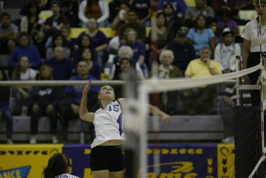 Hannah Hamblin, then known as Hannah Washburn, competes during a 2011 Kirtland Central High School volleyball game.