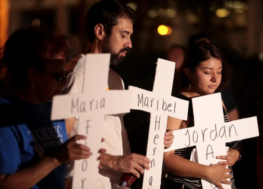 Coachella Valley residents gather for a vigil and moment of silence for the victims of the El Paso mass shooting in front of the courthouse in Indio, Calif., on Tuesday, August 20, 2019.