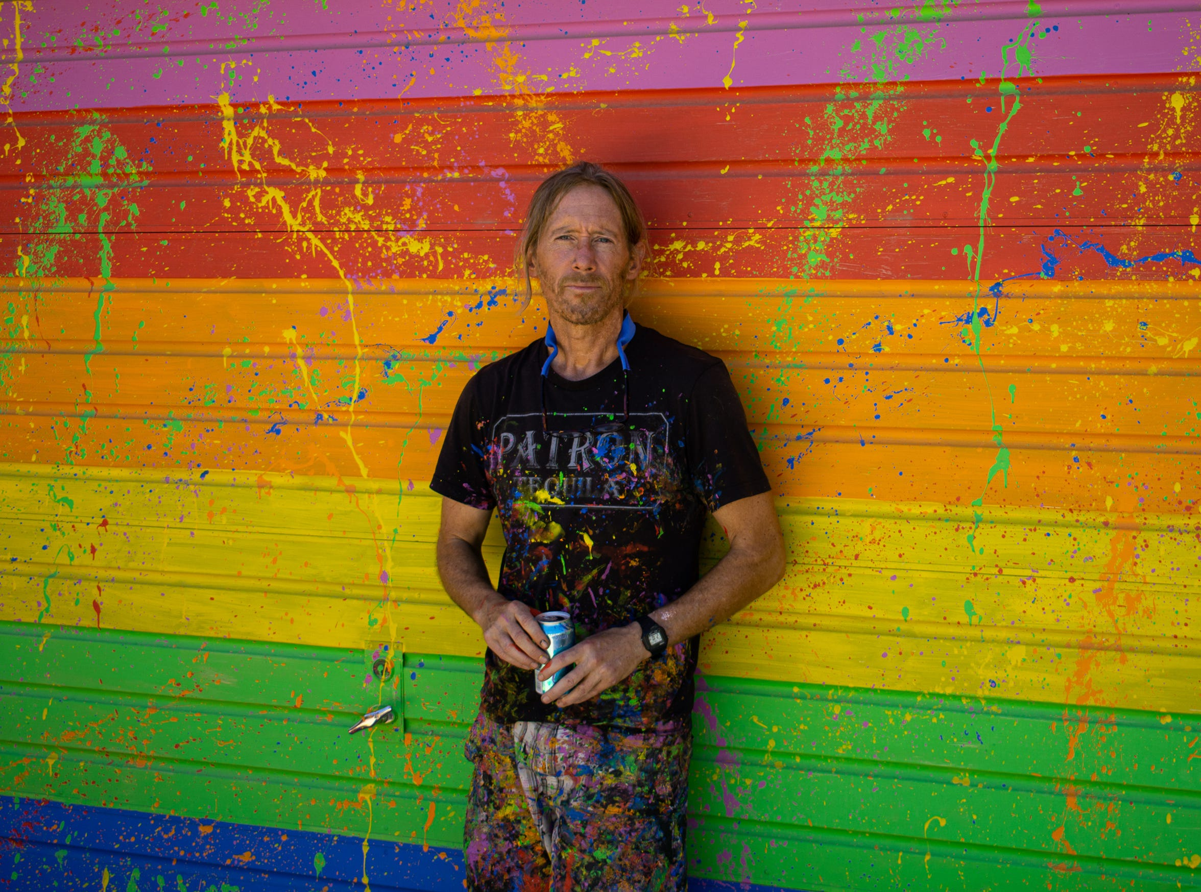 Artist Patrick Hasson poses in front of his studio at Rancho El Reposo in Joshua Tree, Calif. on Aug. 19, 2019.