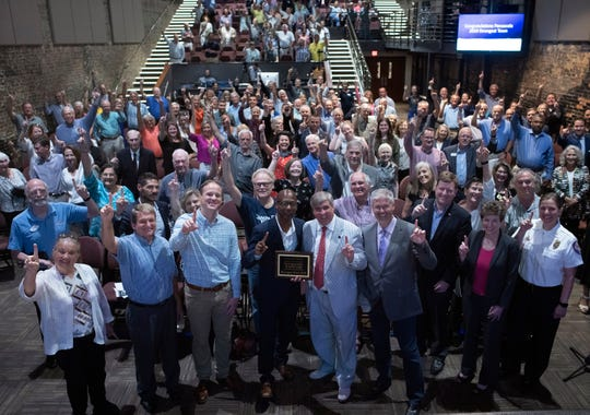 Pensacola civic and community leaders celebrate after being named as the 2019 Strongest Town contest winner during a ceremony at the REX Theatre on Tuesday, Aug. 20, 2019.