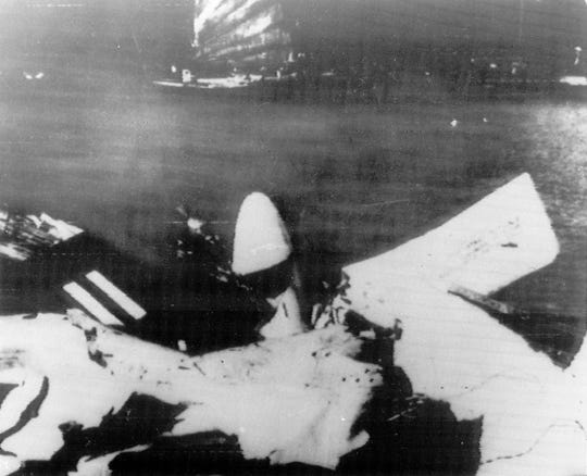 The wreckage of a plane piloted by Lt. Cmdr. Everett Alvarez Jr. is shown after the image was released by Hanoi, Aug. 5, 1964.