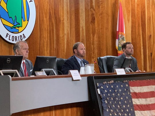 From left, state Sen. Doug Broxson and House Reps. Jayer Williamson and Alex Andrade listen to members of the public at the 2019 Santa Rosa County legislative delegation public hearing in Milton.