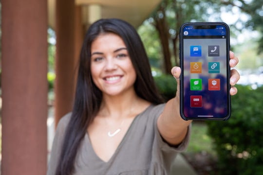 University of West Florida student using the new Guardian app, which aims to heighten the safety measures for all students at UWF.