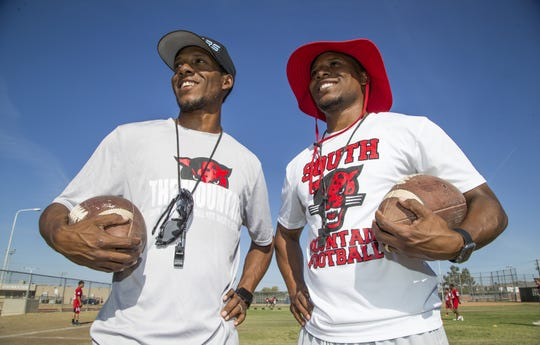 Mark and Marcus Carter are twin brothers who coach the South Mountain High School football team.   Tom Tingle/The Republic Mark and Marcus Carter are twin brothers who coach the South Mountain High School football team. They pose at practice at the school, Wednesday, April 25, 2018.