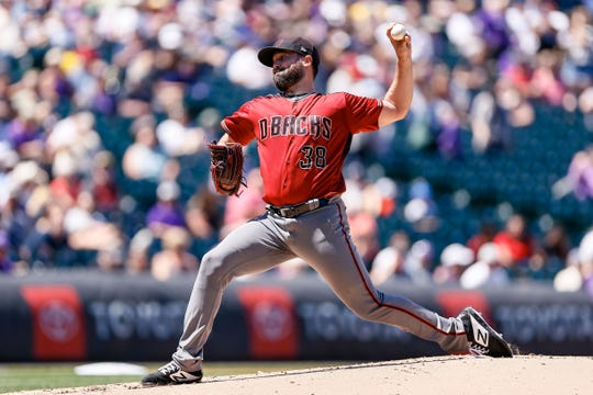 Robbie Ray pitches during the first inning of a game against the Rockies on Aug. 14 at Coors Field.