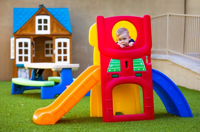 Beaux Gafford,1, takes a break on the playground at the Magical Journey Learning Center in Ahwatukee on Aug. 13, 2019.