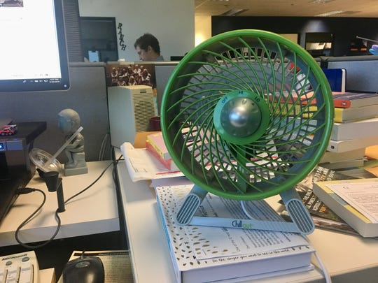 I love my lime-green fan, its constant cooling breeze, the buzzing, click-clacking of it annoying my coworkers.
