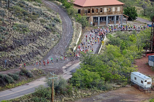 Runners make their way through the streets of the former mining town on the annual Jerome Hill Climb.