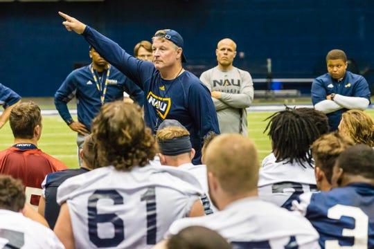 Northern Arizona football  head coach Chris Ball talks to his team players during practice.