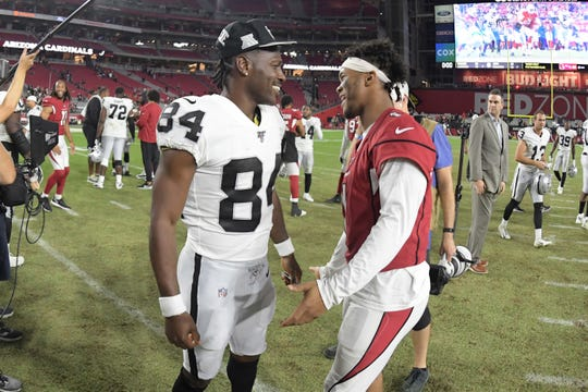 Raiders receiver Antonio Brown and Cardinals quarterback Kyler Murray meets on the field after a preseason game.